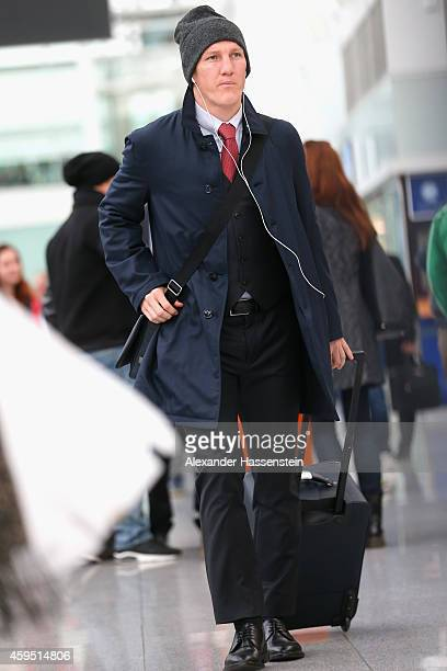 Bastian Schweinsteiger of FC Bayern Muenchen arrives with the team at Munich Airport to depart for their UEFA Champions League match against...