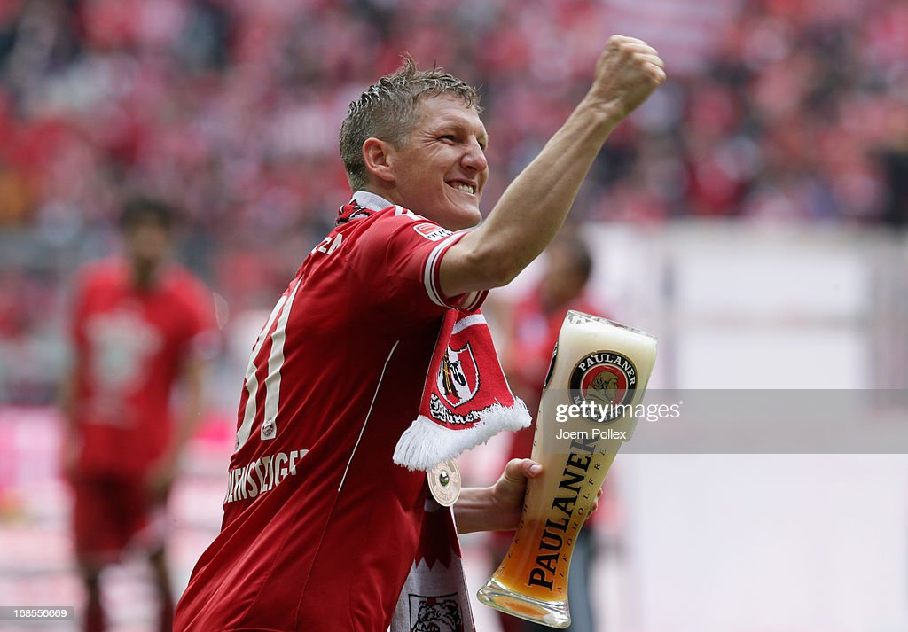<a gi-track='captionPersonalityLinkClicked' href=/galleries/search?phrase=Bastian+Schweinsteiger&family=editorial&specificpeople=203122 ng-click='$event.stopPropagation()'>Bastian Schweinsteiger</a> of FC Bayern Muenchen celebrates following his team's match against Augsburg at the Allianz Arena on May 11, 2013 in Munich, Germany.