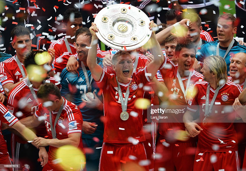 <a gi-track='captionPersonalityLinkClicked' href=/galleries/search?phrase=Bastian+Schweinsteiger&family=editorial&specificpeople=203122 ng-click='$event.stopPropagation()'>Bastian Schweinsteiger</a> of FC Bayern Muenchen lifts the Bundesliga trophy after the Bundesliga match between FC Bayern Muenchen and FC Augsburg at the Allianz Arena on May 11, 2013 in Munich, Germany.