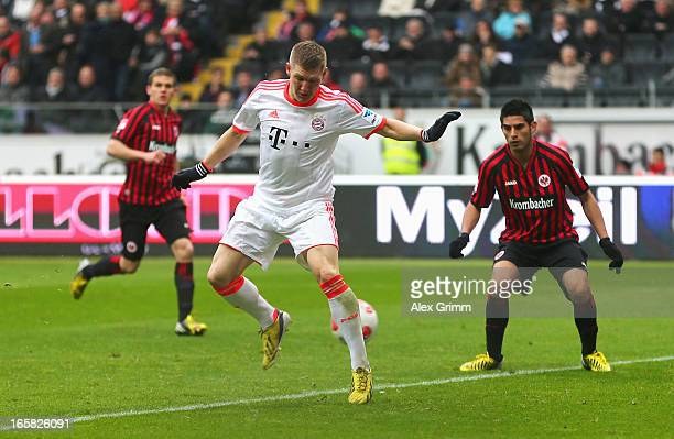 Bastian Schweinsteiger of FC Bayern Muenchen scores the opening goal during the Bundesliga match between Eintracht Frankfurt and FC Bayern Muenchen...