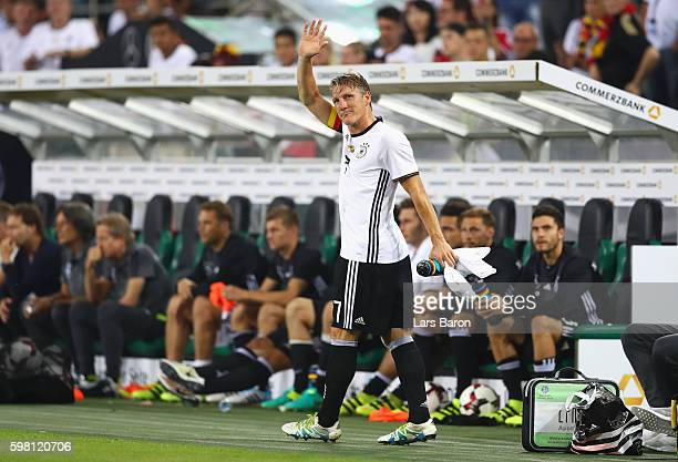 Bastian Schweinsteiger of Germany acknowledges the crowd after being substituted during the International Friendly match between Germany and Finland...