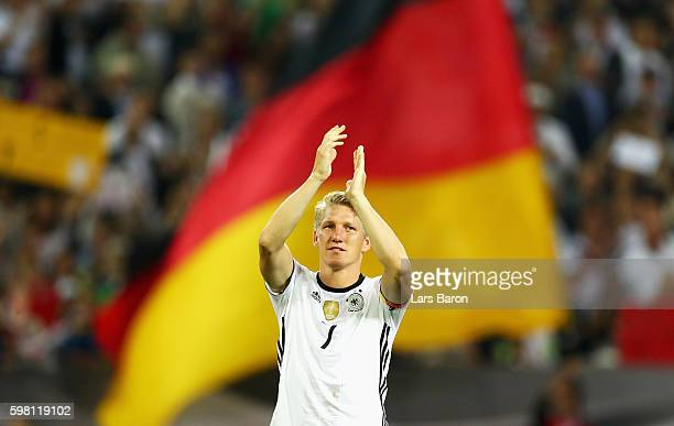 Bastian Schweinsteiger of Germany acknowledges the crowd after his last international match during the International Friendly match between Germany...