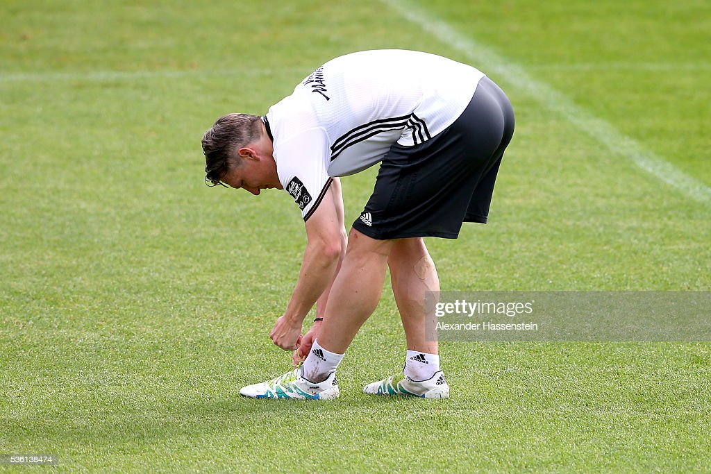 <a gi-track='captionPersonalityLinkClicked' href=/galleries/search?phrase=Bastian+Schweinsteiger&family=editorial&specificpeople=203122 ng-click='$event.stopPropagation()'>Bastian Schweinsteiger</a> of Germany adjust his boots during a training session at Stadio communale on day 8 of the German national team trainings camp on May 31, 2016 in Ascona, Switzerland.