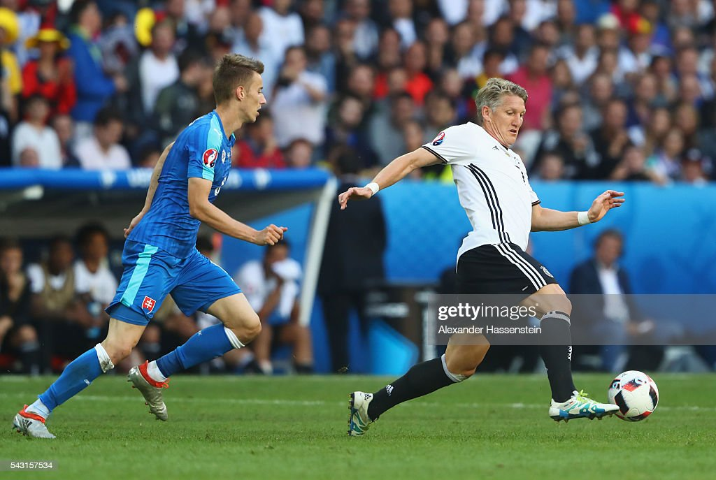 <a gi-track='captionPersonalityLinkClicked' href=/galleries/search?phrase=Bastian+Schweinsteiger&family=editorial&specificpeople=203122 ng-click='$event.stopPropagation()'>Bastian Schweinsteiger</a> of Germany and Jan Gregua of Slovakia compete for the ball during the UEFA EURO 2016 round of 16 match between Germany and Slovakia at Stade Pierre-Mauroy on June 26, 2016 in Lille, France.