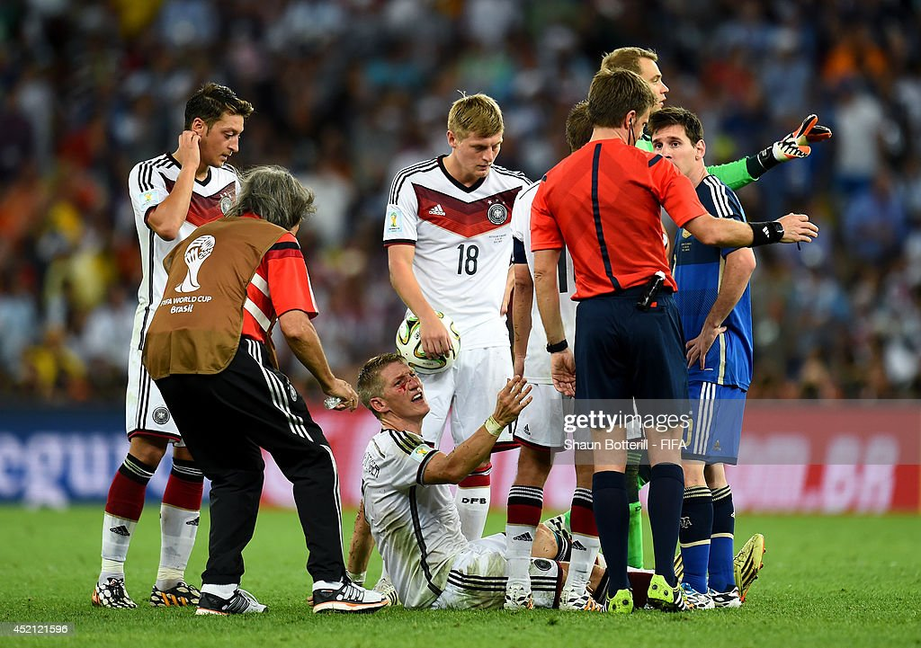 Bastian Schweinsteiger of Germany appeals to referee Nicola Rizzoli as he bleeds after a clash during the 2014 FIFA World Cup Brazil Final match between Germany and Argentina at Maracana on July 13, 2014 in Rio de Janeiro, Brazil.