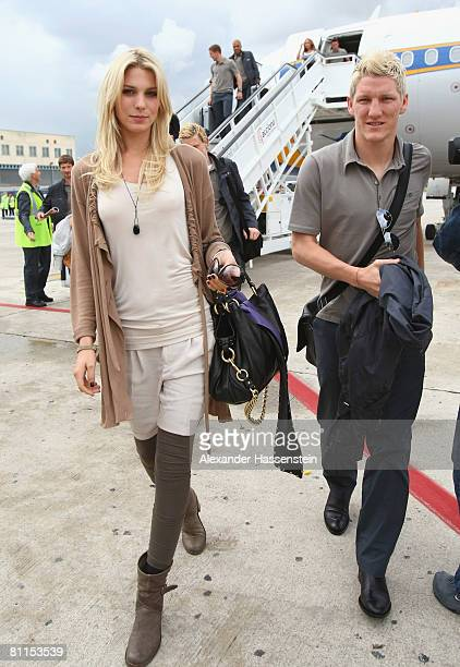 Bastian Schweinsteiger of Germany arrives with his girlfriend Sarah Brandner at Palma Airport on May 19 2008 in Palma de Mallorca Spain The German...