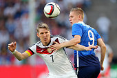 Bastian Schweinsteiger of Germany battles for the ball with Aron Johannsson of USA during the international friendly match between Germany and USA at...