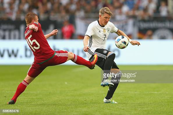Bastian Schweinsteiger of Germany battles for the ball with Laszlo Kleinheisler of Hungary during the international friendly match between Germany...