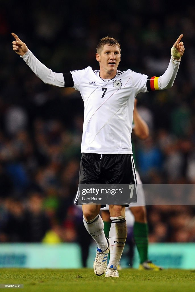 <a gi-track='captionPersonalityLinkClicked' href=/galleries/search?phrase=Bastian+Schweinsteiger&family=editorial&specificpeople=203122 ng-click='$event.stopPropagation()'>Bastian Schweinsteiger</a> of Germany celebrates during the FIFA 2014 World Cup Qualifier group C match between Republic of Ireland and Germany at Aviva Stadium on October 12, 2012 in Dublin, Ireland.