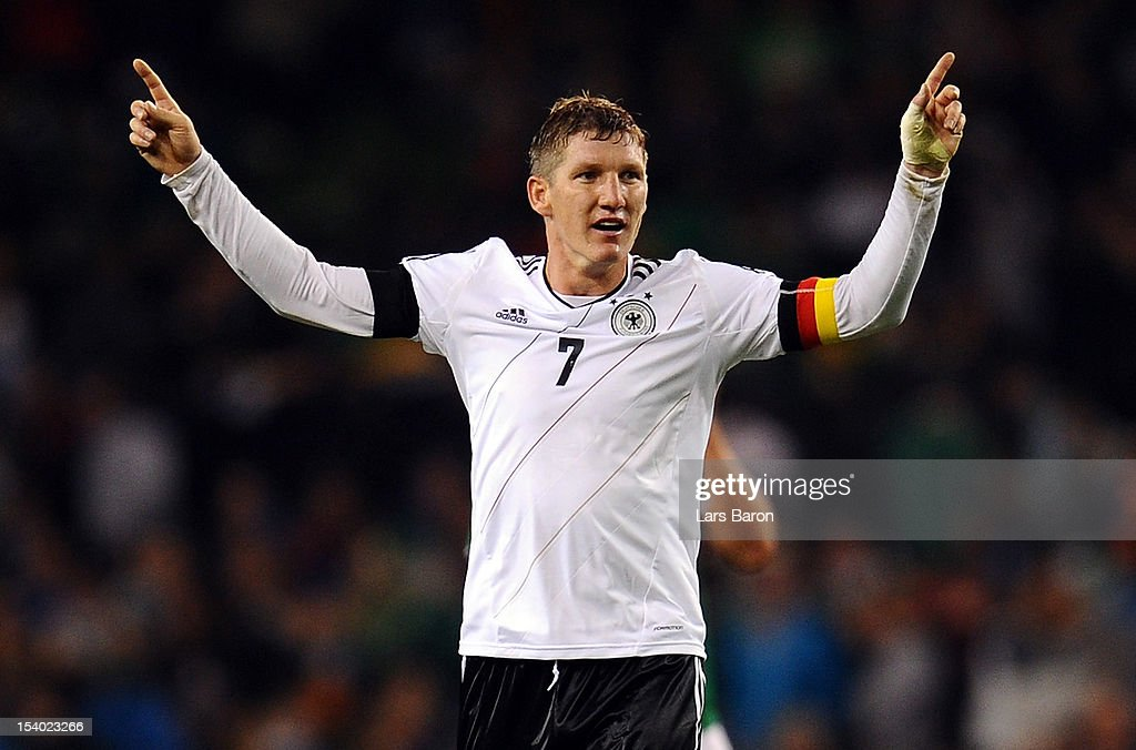 Bastian Schweinsteiger of Germany celebrates during the FIFA 2014 World Cup Qualifier group C match between Republic of Ireland and Germany at Aviva Stadium on October 12, 2012 in Dublin, Ireland.