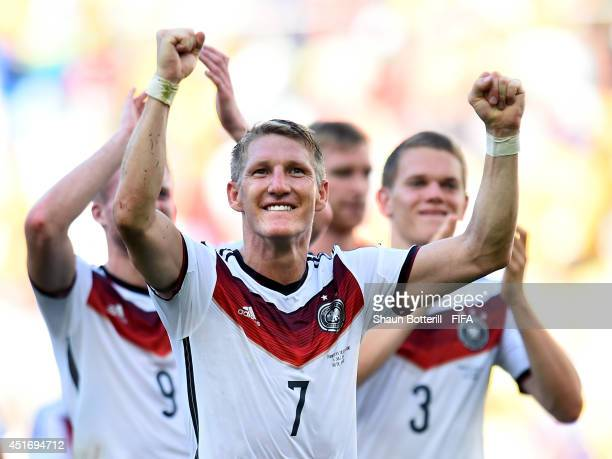 Bastian Schweinsteiger of Germany celebrates the 10 win after the 2014 FIFA World Cup Brazil Quarter Final match between France and Germany at...