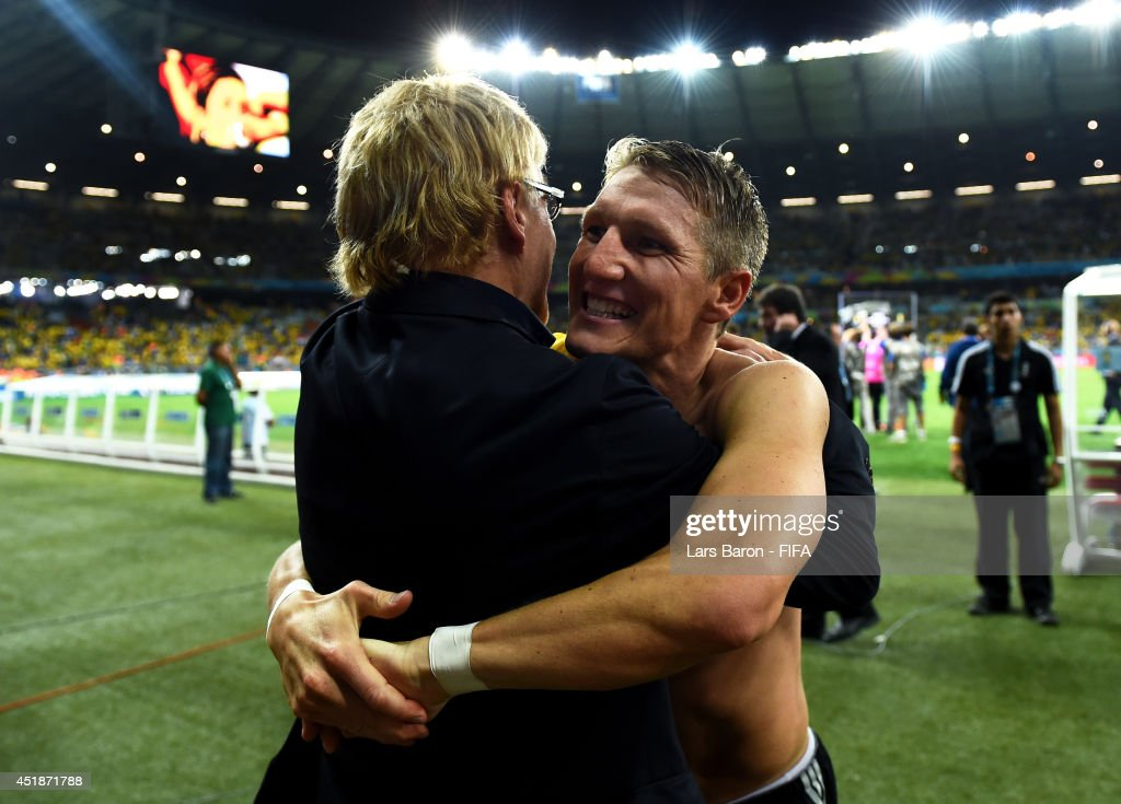 <a gi-track='captionPersonalityLinkClicked' href=/galleries/search?phrase=Bastian+Schweinsteiger&family=editorial&specificpeople=203122 ng-click='$event.stopPropagation()'>Bastian Schweinsteiger</a> of Germany celebrates the 7-1 win with chief scout Urs Siegenthaler after the 2014 FIFA World Cup Brazil Semi Final match between Brazil and Germany at Estadio Mineirao on July 8, 2014 in Belo Horizonte, Brazil.