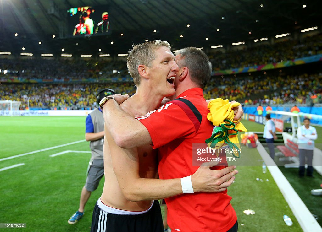 Bastian Schweinsteiger of Germany celebrates the 7-1 win with kit man Thomas Mai after the 2014 FIFA World Cup Brazil Semi Final match between Brazil and Germany at Estadio Mineirao on July 8, 2014 in Belo Horizonte, Brazil.