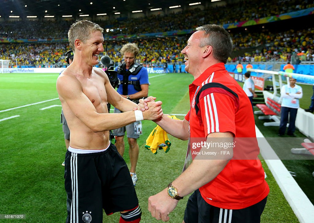 <a gi-track='captionPersonalityLinkClicked' href=/galleries/search?phrase=Bastian+Schweinsteiger&family=editorial&specificpeople=203122 ng-click='$event.stopPropagation()'>Bastian Schweinsteiger</a> of Germany celebrates the 7-1 win with kit man Thomas Mai after the 2014 FIFA World Cup Brazil Semi Final match between Brazil and Germany at Estadio Mineirao on July 8, 2014 in Belo Horizonte, Brazil.
