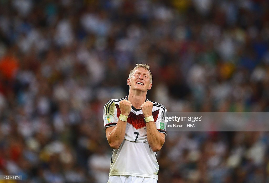 Bastian Schweinsteiger of Germany celebrates victory after the 2014 FIFA World Cup Brazil Final match between Germany and Argentina at Maracana on July 13, 2014 in Rio de Janeiro, Brazil.