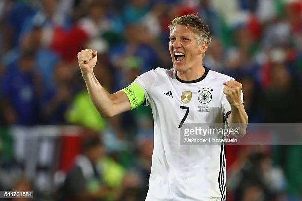 Bastian Schweinsteiger of Germany celebrates victory after winning the UEFA EURO 2016 quarter final match between Germany and Italy at Stade Matmut...
