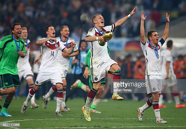 Bastian Schweinsteiger of Germany celebrates with the World Cup trophy after defeating Argentina 10 in extra time during the 2014 FIFA World Cup...