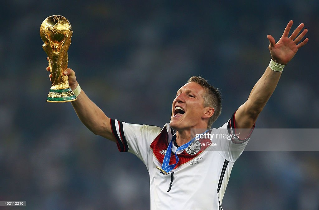 <a gi-track='captionPersonalityLinkClicked' href=/galleries/search?phrase=Bastian+Schweinsteiger&family=editorial&specificpeople=203122 ng-click='$event.stopPropagation()'>Bastian Schweinsteiger</a> of Germany celebrates with the World Cup trophy after defeating Argentina 1-0 in extra time during the 2014 FIFA World Cup Brazil Final match between Germany and Argentina at Maracana on July 13, 2014 in Rio de Janeiro, Brazil.