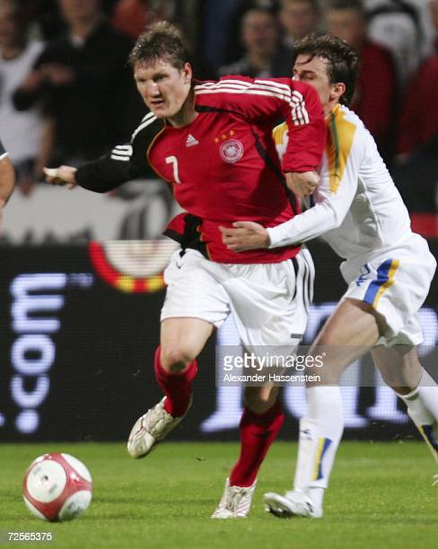 Bastian Schweinsteiger of Germany challenge for the ball with Georgios Theodotou of Cyprus during the Euro2008 qualifying match between Cyprus and...