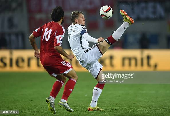 Bastian Schweinsteiger of Germany controls the ball against Tornike Okriashvili of Georgia during the EURO 2016 Group D Qualifier match between...