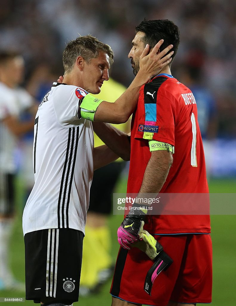 Bastian Schweinsteiger of Germany embraces Gianluigi Buffon of Italy at fulltime following the UEFA Euro 2016 Quarter Final match between Germany and...