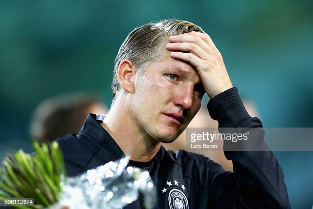 Bastian Schweinsteiger of Germany gets emotional prior to his last international match the International Friendly match between Germany and Finland...