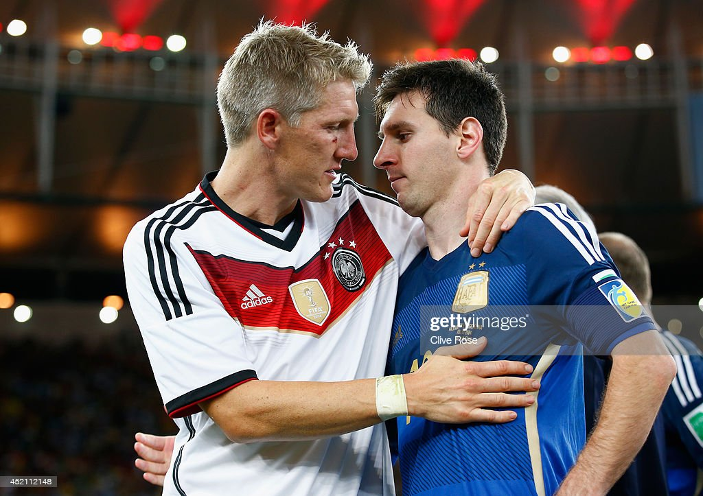 <a gi-track='captionPersonalityLinkClicked' href=/galleries/search?phrase=Bastian+Schweinsteiger&family=editorial&specificpeople=203122 ng-click='$event.stopPropagation()'>Bastian Schweinsteiger</a> of Germany hugs <a gi-track='captionPersonalityLinkClicked' href=/galleries/search?phrase=Lionel+Messi&family=editorial&specificpeople=453305 ng-click='$event.stopPropagation()'>Lionel Messi</a> of Argentina after Germany's 1-0 victory in extra time during the 2014 FIFA World Cup Brazil Final match between Germany and Argentina at Maracana on July 13, 2014 in Rio de Janeiro, Brazil.