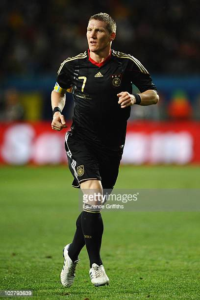 Bastian Schweinsteiger of Germany in action during the 2010 FIFA World Cup South Africa Third Place Playoff match between Uruguay and Germany at The...