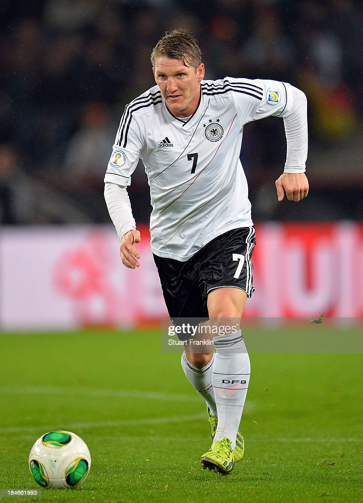 <a gi-track='captionPersonalityLinkClicked' href=/galleries/search?phrase=Bastian+Schweinsteiger&family=editorial&specificpeople=203122 ng-click='$event.stopPropagation()'>Bastian Schweinsteiger</a> of Germany in action during the FIFA world Cup 2014 qualification match between Germany and Republic of Ireland at the Rheinenergy stadium on October 11, 2013 in Cologne, Germany.