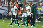 Bastian Schweinsteiger of Germany is substitute by his team mate Toni Kroos during the international friendly match between Germany and Hungary at...