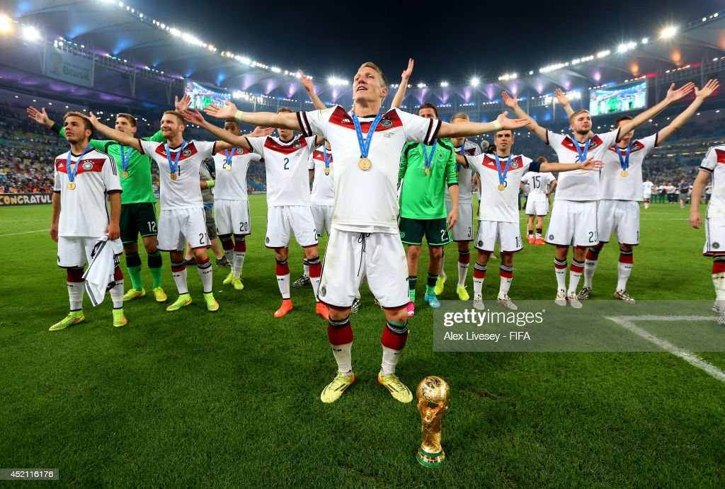 <a gi-track='captionPersonalityLinkClicked' href=/galleries/search?phrase=Bastian+Schweinsteiger&family=editorial&specificpeople=203122 ng-click='$event.stopPropagation()'>Bastian Schweinsteiger</a> of Germany leads team-mates in celebration after the 2014 FIFA World Cup Brazil Final match between Germany and Argentina at Maracana on July 13, 2014 in Rio de Janeiro, Brazil.