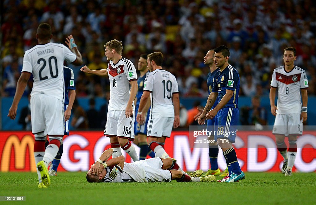 Bastian Schweinsteiger of Germany lies injured after a clash during the 2014 FIFA World Cup Brazil Final match between Germany and Argentina at Maracana on July 13, 2014 in Rio de Janeiro, Brazil.