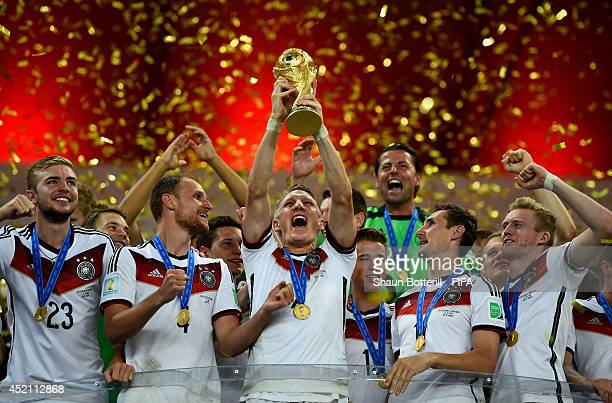 Bastian Schweinsteiger of Germany lifts the World Cup to celebrate with his teammates during the award ceremony after the 2014 FIFA World Cup Brazil...