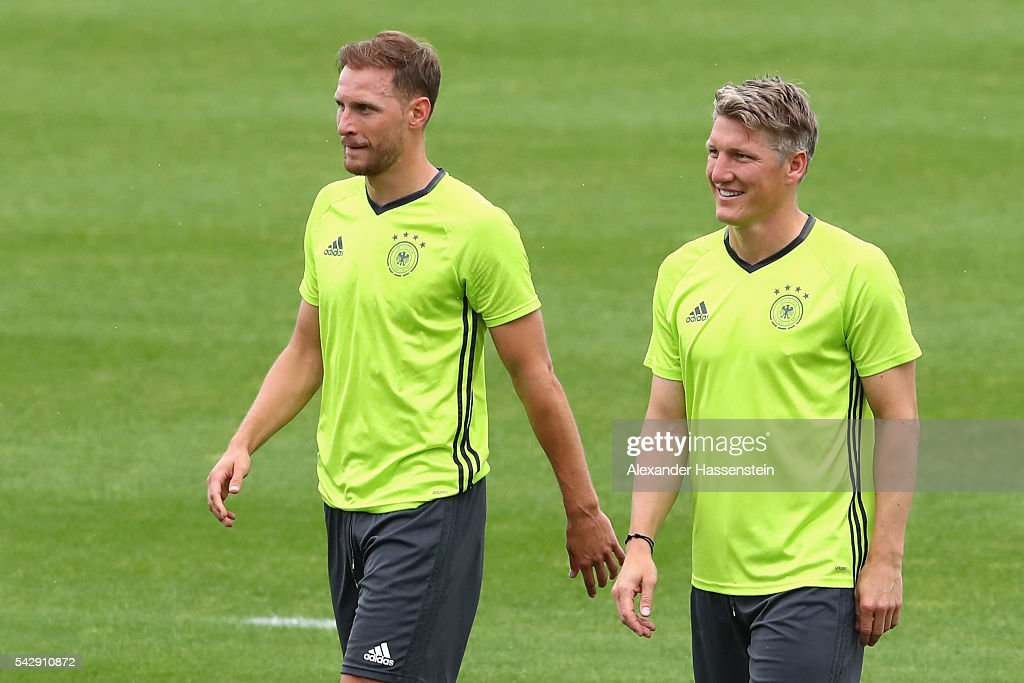 <a gi-track='captionPersonalityLinkClicked' href=/galleries/search?phrase=Bastian+Schweinsteiger&family=editorial&specificpeople=203122 ng-click='$event.stopPropagation()'>Bastian Schweinsteiger</a> of Germany looks on with his team mate <a gi-track='captionPersonalityLinkClicked' href=/galleries/search?phrase=Benedikt+Hoewedes&family=editorial&specificpeople=3945465 ng-click='$event.stopPropagation()'>Benedikt Hoewedes</a> (L) during a Germany training session ahead of their Euro 2016 round of 16 match against Slovakia at Ermitage Evian on June 25, 2016 in Evian-les-Bains, France.
