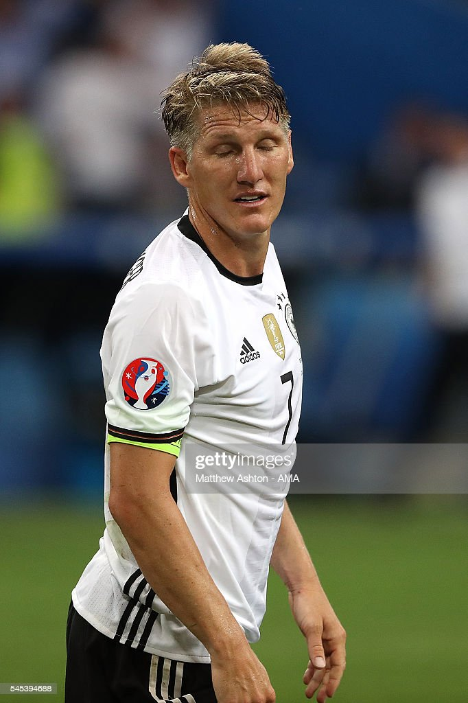 Bastian Schweinsteiger of Germany reacts after Antoine Griezmann of France scored a goal to make the score 02 during the UEFA Euro 2016 Semi Final...