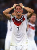 Bastian Schweinsteiger of Germany reacts after defeating Argentina 10 in extra time during the 2014 FIFA World Cup Brazil Final match between Germany...