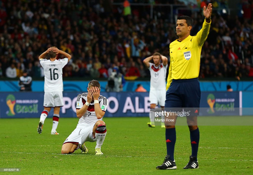 <a gi-track='captionPersonalityLinkClicked' href=/galleries/search?phrase=Bastian+Schweinsteiger&family=editorial&specificpeople=203122 ng-click='$event.stopPropagation()'>Bastian Schweinsteiger</a> of Germany reacts as referee <a gi-track='captionPersonalityLinkClicked' href=/galleries/search?phrase=Sandro+Ricci&family=editorial&specificpeople=9145717 ng-click='$event.stopPropagation()'>Sandro Ricci</a> gestures during the 2014 FIFA World Cup Brazil Round of 16 match between Germany and Algeria at Estadio Beira-Rio on June 30, 2014 in Porto Alegre, Brazil.