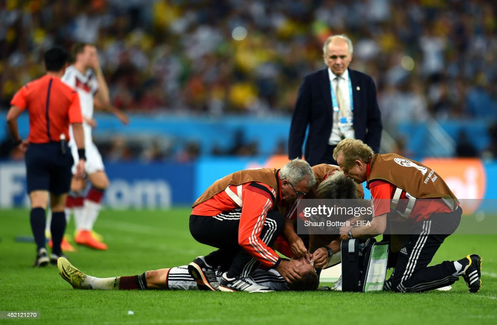 Bastian Schweinsteiger of Germany receives a medical treatment during the 2014 FIFA World Cup Brazil Final match between Germany and Argentina at Maracana on July 13, 2014 in Rio de Janeiro, Brazil.