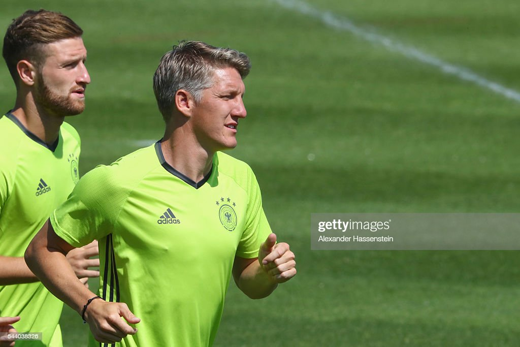 <a gi-track='captionPersonalityLinkClicked' href=/galleries/search?phrase=Bastian+Schweinsteiger&family=editorial&specificpeople=203122 ng-click='$event.stopPropagation()'>Bastian Schweinsteiger</a> of Germany runs during a Germany training session ahead of their Euro 2016 quarter final match against Italy at Ermitage Evian on July 01, 2016 in Evian-les-Bains, France.