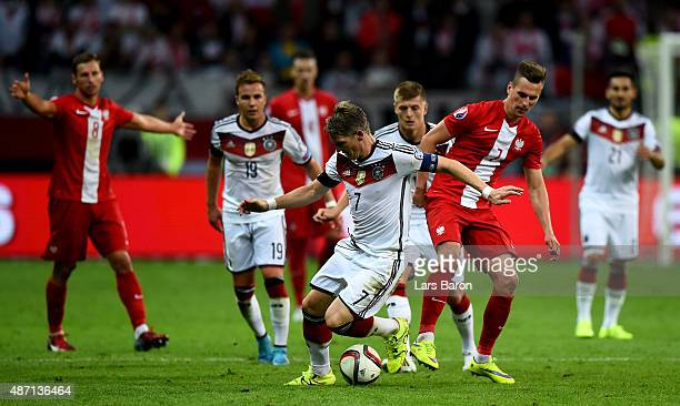 Bastian Schweinsteiger of Germany runs with the ball during the EURO 2016 Qualifier Group D match between Germany and Poland on September 4 2015 in...