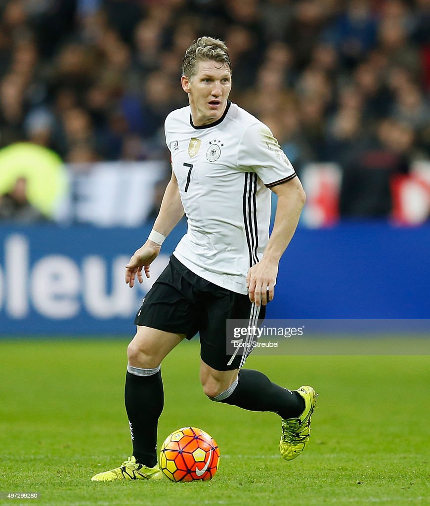 Bastian Schweinsteiger of Germany runs with the ball during the International Friendly match between France and Germany at the Stade de France on...