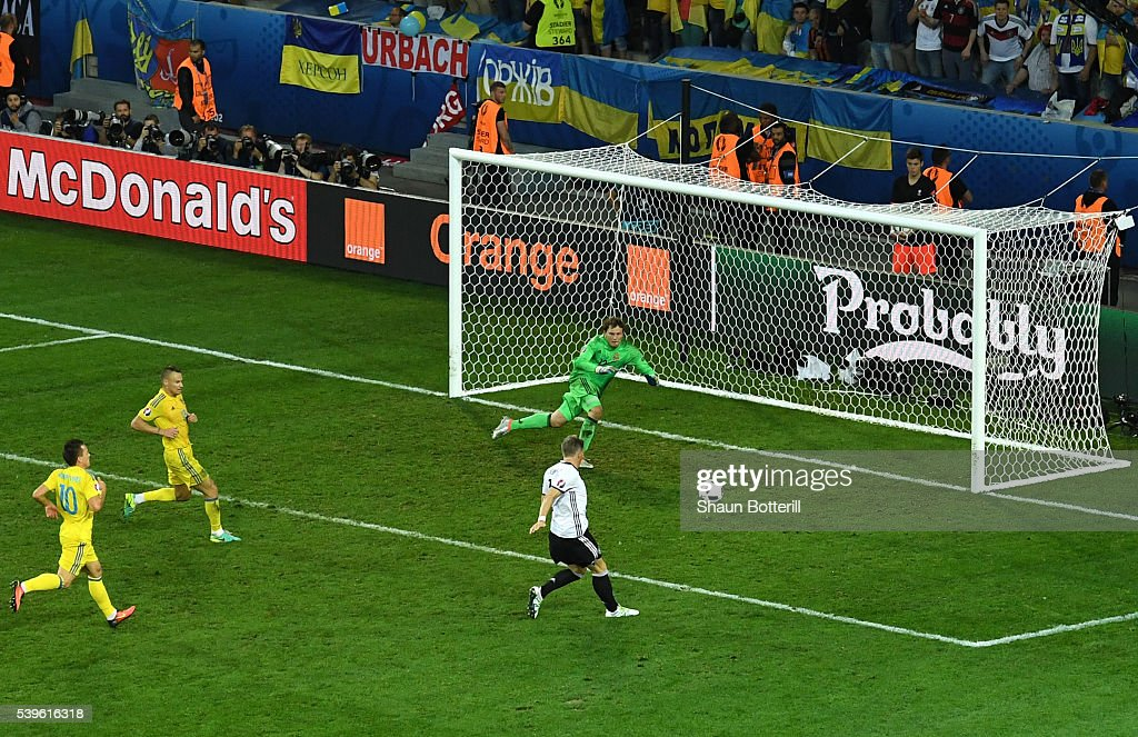 Bastian Schweinsteiger of Germany scores his team's second goal past Andriy Pyatov of Ukraine during the UEFA EURO 2016 Group C match between Germany and Ukraine at Stade Pierre-Mauroy on June 12, 2016 in Lille, France.