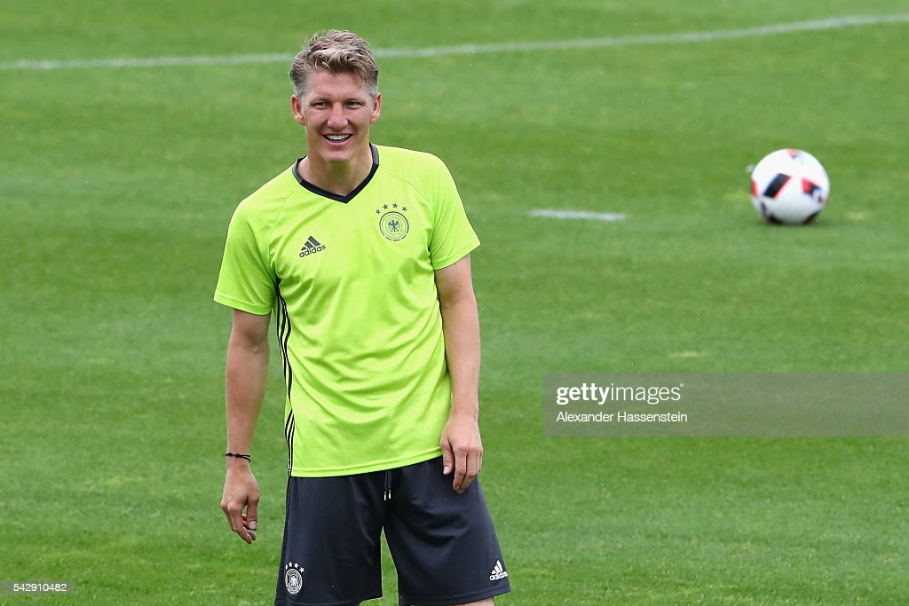 Bastian Schweinsteiger of Germany smiles during a Germany training session ahead of their Euro 2016 round of 16 match against Slovakia at Ermitage Evian on June 25, 2016 in Evian-les-Bains, France.