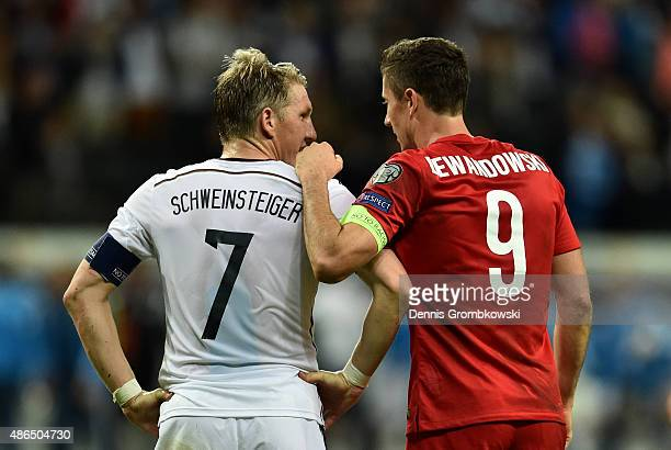 Bastian Schweinsteiger of Germany talks to Robert Lewandowski of Poland after the EURO 2016 Qualifier Group D match between Germany and Poland at...