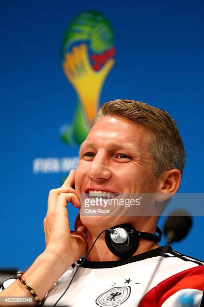 Bastian Schweinsteiger of Germany talks to the media during a press conference at Maracana on July 12 2014 in Rio de Janeiro Brazil