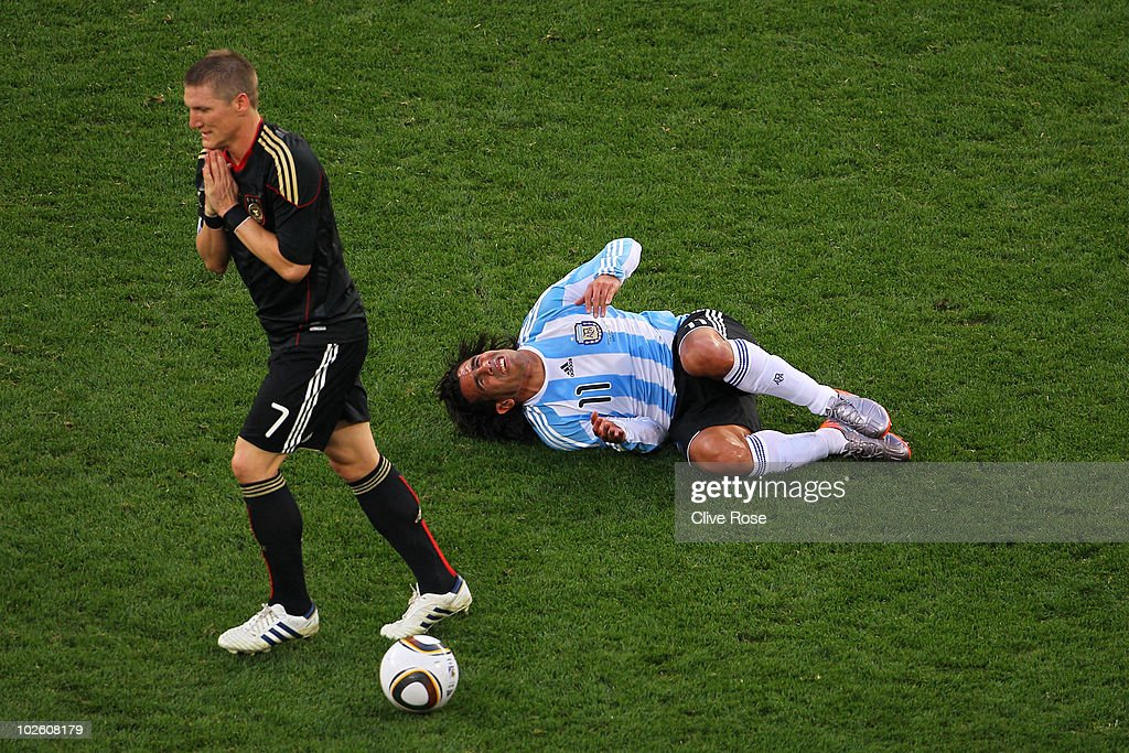 Bastian Schweinsteiger of Germany walks away from a challenge on Carlos Tevez of Argentina during the 2010 FIFA World Cup South Africa Quarter Final...