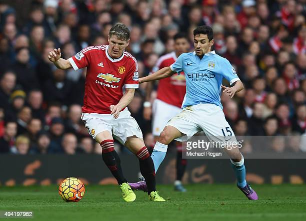 Bastian Schweinsteiger of Manchester United and Jesus Navas of Manchester City compete for the ball during the Barclays Premier League match between...