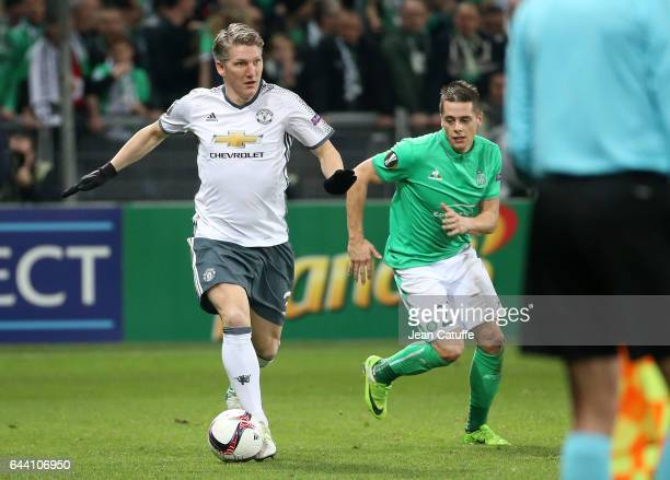 Bastian Schweinsteiger of Manchester United and Romain Hamouma of SaintEtienne in action during the UEFA Europa League Round of 32 second leg match...