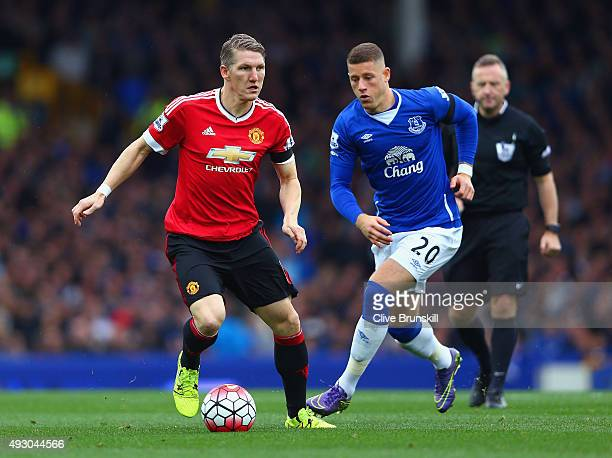 Bastian Schweinsteiger of Manchester United and Ross Barkley of Everton compete for the ball during the Barclays Premier League match between Everton...