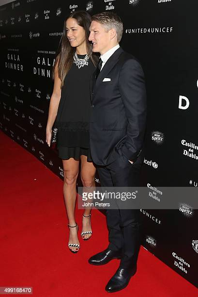 Bastian Schweinsteiger of Manchester United arrives with his partner tennis player Ana Ivanovic for the United for UNICEF Gala Dinner at Old Trafford...